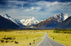 Landscape with road and snowy mountains Southern Alps New Zealand